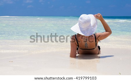 Monika enjoying her holiday at the beach of Kuredu, maldives - stock photo