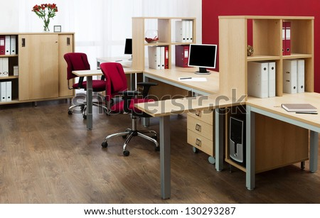 monitor on a desk in a modern office - stock photo