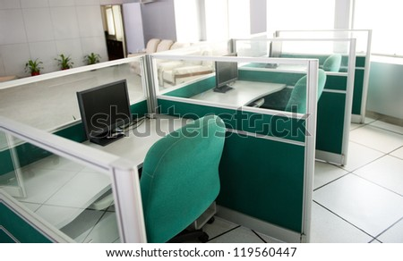 monitor on a desk in a office. - stock photo