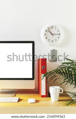 Monitor on a desk in creative office./  Modern creative workspace.  - stock photo