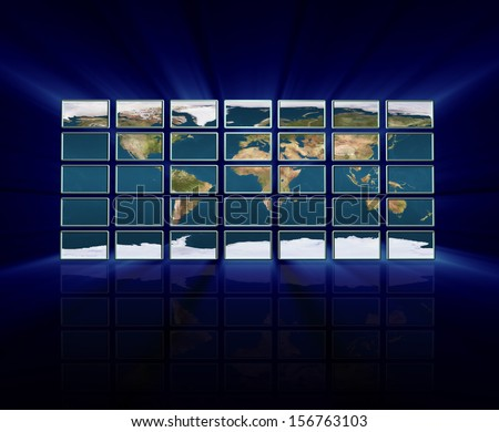 Monitor wall with earth at night map - stock photo