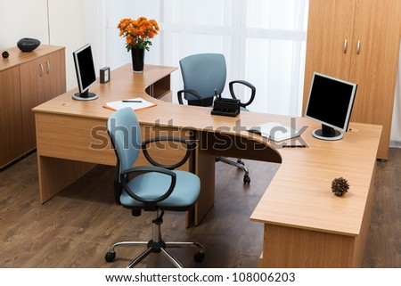 monitors on a desk at modern office - stock photo