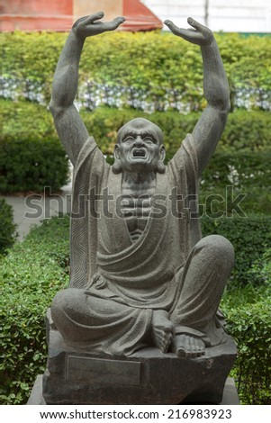 Monk fighter master statue in combat pose - stock photo