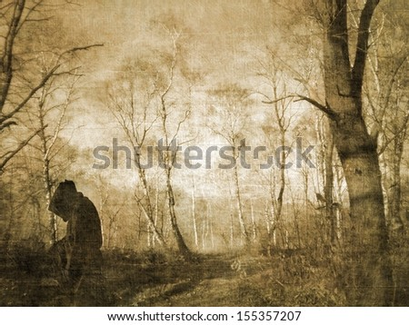 Monk figure praying in the forest - stock photo