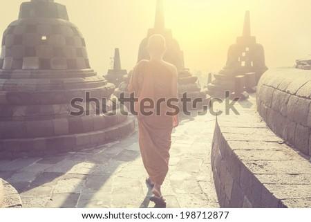 Monk in Barabudur temple, Java, Indonesia - stock photo