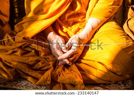 Monk's hand in Buddhism ceremony  - stock photo