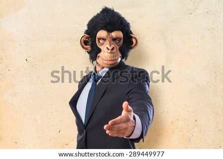 Monkey man making a deal over textured background   - stock photo