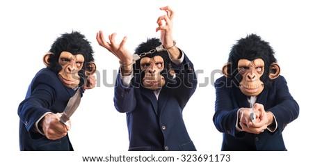 Monkey man with handcuffs - stock photo