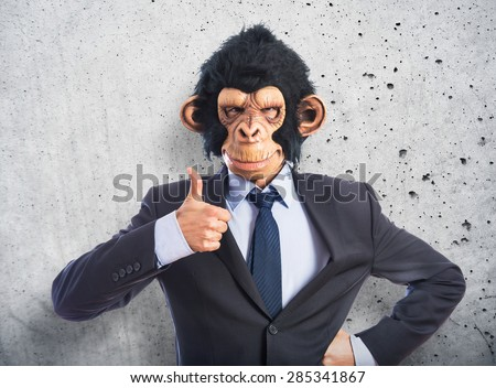 Monkey man with thumb up over textured background - stock photo