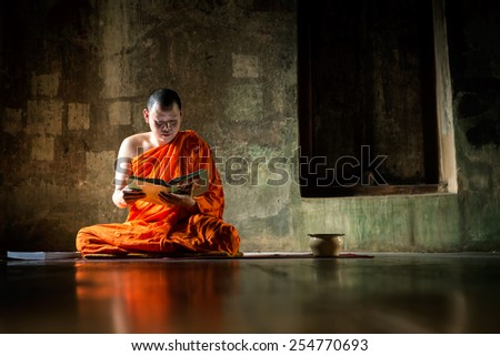 Monks at Putthaisawan temple in Ayutthaya, Thailand. - stock photo