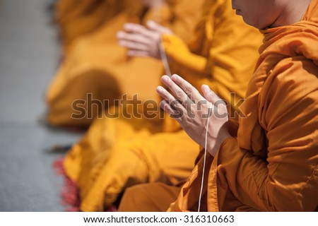 Monks of the religious rituals, Buddhist ceremony, Pray ,Put the palms of the hands together in salute  - stock photo