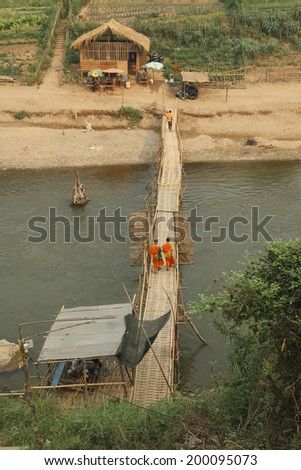 Monks on the deck of the Mekong, Luang Prabang, Laos - stock photo