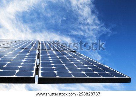 Mono-crystalline photovoltaic solar cell panels producing electricity - stock photo