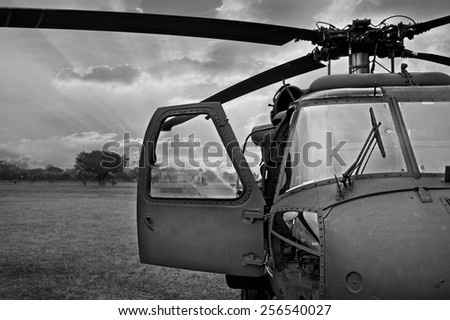 monochrome black and white Front view of military helicopter cockpit - stock photo