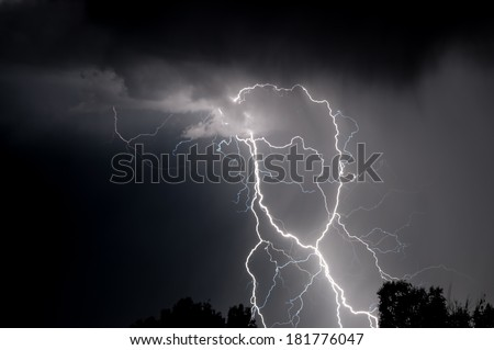 Monochrome cloud to ground multiple lightning strike representing the look of spaghetti - stock photo