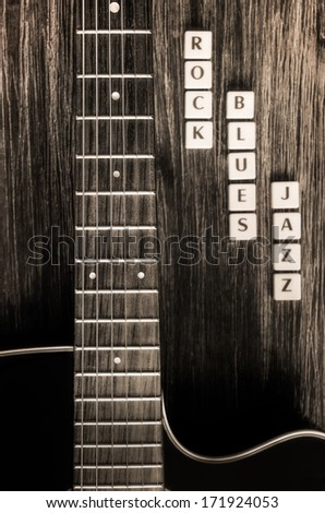 Monochrome detail of guitar and signs rock blues jazz in vintage style - stock photo