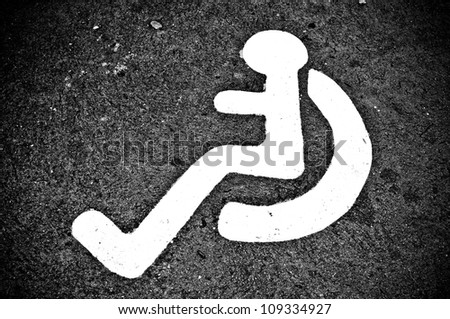 Monochrome Disability sign in car parking - stock photo