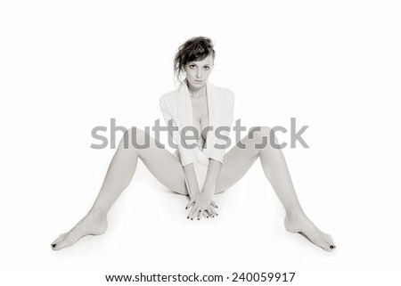 Monochrome fashion portrait of a beautiful woman in white pullover, in front of white studio background - stock photo