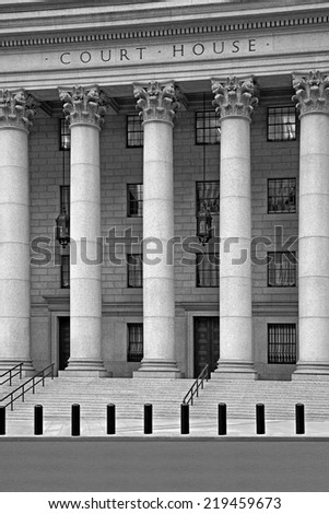 monochrome image inscription on the courthouse close-up - stock photo