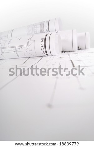 Monochrome image of rolled up blueprints - stock photo