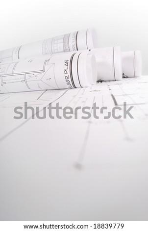 Monochrome image of rolled up blueprints - stock photo