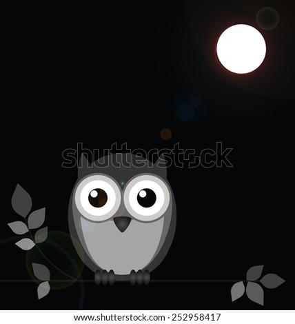 Monochrome owl bathed in moonlight with lens flare  - stock photo
