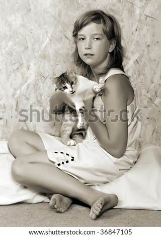 Monochrome portrait of a pretty girl with cat. - stock photo