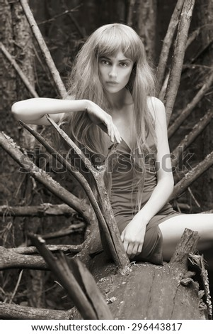 monochrome portrait of beautiful blonde girl. fantasy young woman in woods - stock photo