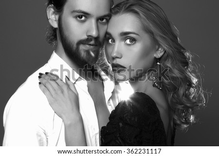 monochrome portrait of lovely couple. Beautiful woman near the man.beauty girl and boy together - stock photo