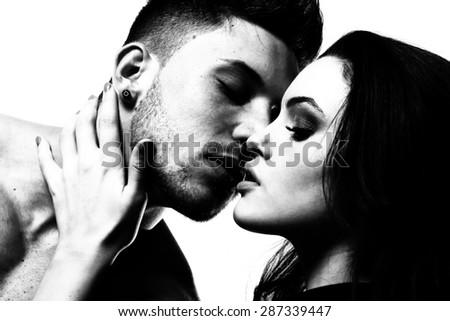 Monochrome portrait of man and woman: Pure passion - stock photo