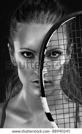 Monochrome portrait of young woman tennis player - stock photo