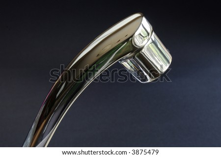 Monochrome tap over a dark background - stock photo