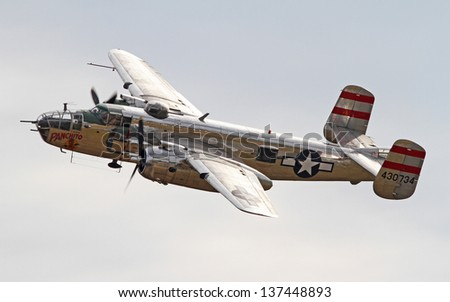 MONROE, NC - NOVEMBER 4:  World War II B-25 Mitchell Bomber Performing during Warbirds Over Monroe Air Show in Monroe, NC, on November 4, 2012. - stock photo