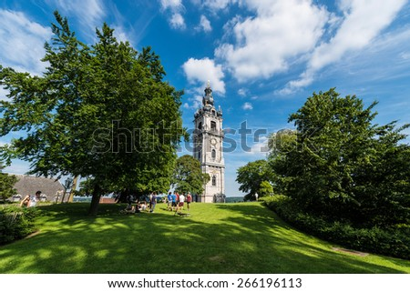 MONS, BELGIUM - JUNE 13, 2014: The belfry, also called El Catiau by Montois, was built in Mons in the 17th century and is the only baroque style building in Belgium that reaches a height of 87 meters. - stock photo