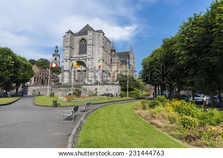 MONS, BELGIUM - JUNE 13, 2014: The Sainte-Waudru Collegiate Church is one of the most characteristic churches and most homogeneous of Brabantine Gothic architecture located in Mons, Belgium - stock photo
