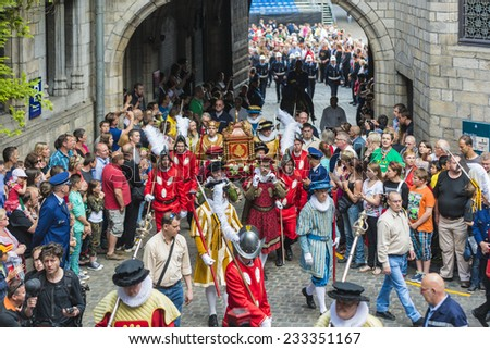 MONS, BELGIUM - JUNE 14, 2014: Waltrude's Shrine Procession within The Ducasse de Mons (Doudou) celebrations, recognized as one of the Masterpieces of the Oral and Intangible Heritage of Humanity. - stock photo