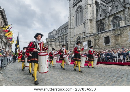 MONS, BELGIUM - JUNE 15, 2014: Waltrude's Shrine Procession within The Ducasse de Mons (Doudou) celebrations, recognized as one of the Masterpieces of the Oral and Intangible Heritage of Humanity. - stock photo