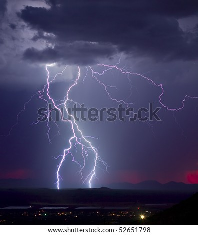 Monsoon storm with a hint of a fading red sunset - stock photo