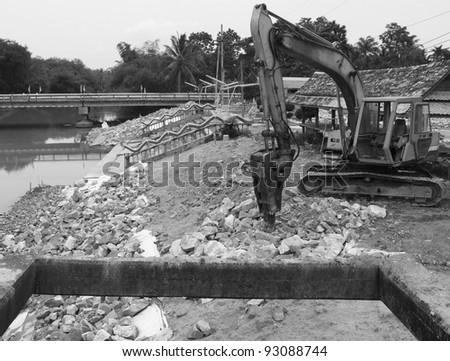 Monster machines during on river side, Black and white. - stock photo