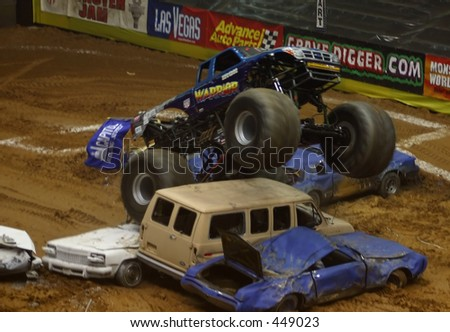 monster truck jumping at monster jam - stock photo