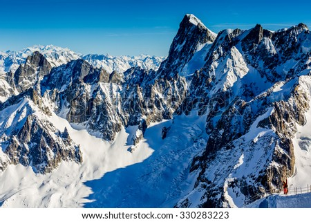 Mont Blanc and Chamonix, view from Aiguille du Midi - stock photo