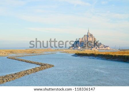 Mont Saint Michel city over sea water,  France - stock photo