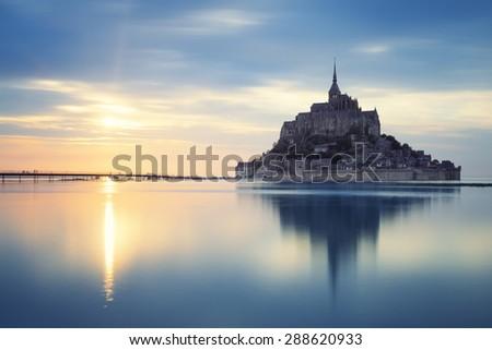 MONT SAINT MICHEL, FRANCE, JUNE 4.View of famous Mont-Saint-Michel at sunset, taken on 4 June 2015, France, Europe.  - stock photo
