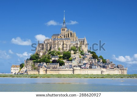 MONT SAINT MICHEL, FRANCE, JUNE 6.View of Mont-Saint-Michel and green grass, taken on 6 June 2015, France, Europe.  - stock photo