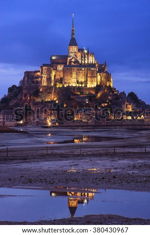 Mont Saint Michel (Saint Michael's Mount) at dusk in Normandy, France. - stock photo