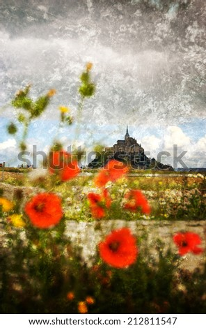 Mont Saint Michel UNESCO heritage site and tourists going toward it. Poppy flowers field under cloudy sky. Normandy, France. Selective focus on Mont Saint Michel. Retro aged photo with scratches. - stock photo