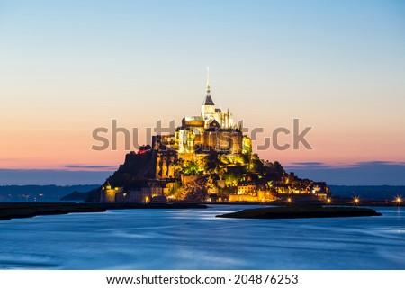 Mont Saint Michele at dusk France - stock photo