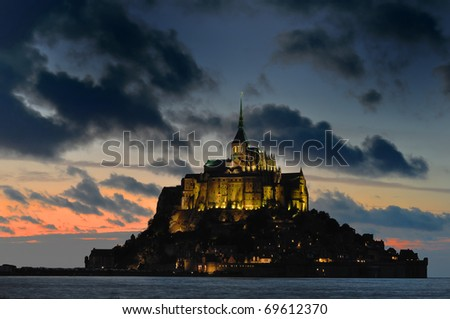 Mont St Michel illuminated at night.  Normandy, France. - stock photo