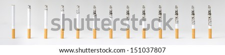 Montage of a burning cigarette in different stages, isolated on white. - stock photo