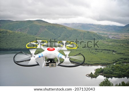 Montage of drone over Coldwater Lake near Mt. St. Helens - stock photo